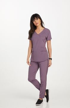 The Barco One Wellness Surplice Scrub Tops is made with stretch fabric and spacious pockets. Cute Nursing Scrubs, Cute Scrubs, Nursing Clothes, Scrubs Outfit, Scrubs Uniform, Greys Anatomy Scrubs, Professional Wear, Scrub Sets, Medical Scrubs
