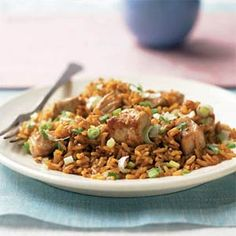 Sesame Pork Rice Recipe | MyRecipes.com -----Brightly flavored with garlic, ginger, soy sauce, and rice vinegar, this pork fried rice recipe is faster than take-out, ready in just 15 minutes.