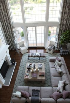 I want a tall living room with lots of windows, just like this! and a fireplace