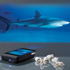 iPhone projector!  Would make traveling with children a bit more pleasant!