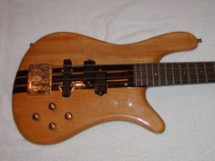 "OWNed = 1986 German Warwick Streamer Stage I neck-thru ... 5-ply Maple neck, Western Cherry Body, High Gloss Natural Finish, Bolivian Rosewood fret board w/ mother-of-pearl inlays, EMG 9v Active ""P"" + ""J"" Pickups ... AWESOME BASS !"