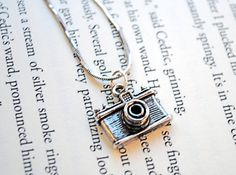 Here's another for Karen - Camera Necklace by KellyStahley on Etsy, $13.00