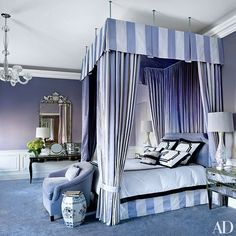 Decorator Susan Maggard translates the semiprecious tones of amethyst into a master bedroom for Lisa and James Cohen's apartment in New York's fabled Plaza hotel. The Anthony Lawrence-Belfair bed is curtained with a Manuel Canovas silk stripe and dressed in Susan Shepherd Interiors bedding   archdigest.com