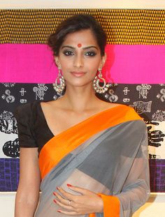 Love this blouse with the simple sari. Love how the earrings are the main jewelry too.