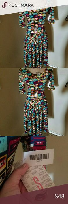 Lularoe Nicole Dress  Tapes! Awesome Tapes dress, NWT Adorable! Not a consultant, just a addict! But need to get rid of a few things. Also moving trying to lighten the load. Have questions? Feel free to ask! Thanks! LuLaRoe Dresses