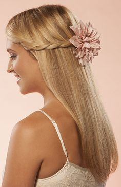Braided crown wedding hair style for long hair. Accessorize with a rose for fairytale weddings or a hibiscus on the beach. http://www.hairperfecter.com/wedding-hair-tips/