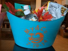 Gift baskets for the guests-tropical adult beverages, decorated wine glasses, water, snacks, sunscreen, etc.