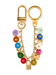 c304ce61b3c3 Gold-tone Louis Vuitton Looping bag charm with multicolor enamel logo charm  embellishments throughout