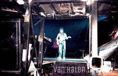 View from Eddie Van Halen's guitar pit below stage as he performs during concert 1986