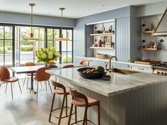 Inside a Colorful Manhattan Townhouse Where Brad Ford Perfectly Blends Old and New - 1stDibs Introspective Mid Century Shelves, Coffee Room, French Oak, Couple, Kitchen Colors, Ceiling Fixtures, Old And New, Kitchen Dining, Kitchen Stools