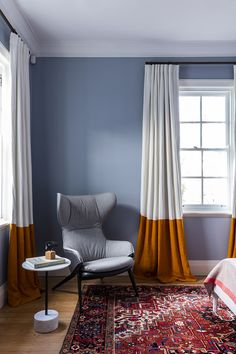 these curtains are pretty and I love the rug -- would prefer a warm cream/off-white wall