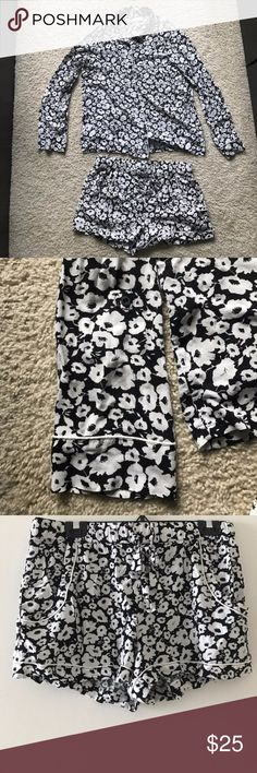 Nordstrom Lingerie Black & White Floral Pajama Set Long sleeved button down top features buttons that allow you to roll up the sleeves. Matching drawstring shorts. Both pieces piped in white. Beautiful, light and airy set. So comfy! Nordstrom Intimates & Sleepwear Pajamas