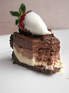 No Bake Triple Chocolate Layer Cheesecake with white chocolate dipped strawberries