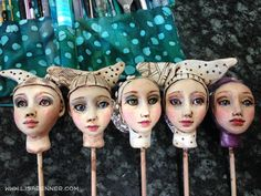 This is a series of polymer clay heads in progress for some art dolls Lisa Renner was making. The eyes are glass beads which she painted.
