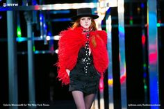 Showtime at Saint Laurent Tough to capture Saint Laurent, but it was sparkly and behatted and there was a green fur for the history buffs. —
