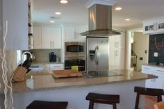 60s Kitchen Remodel - Spaces - Kate McComb...Thinking of something very similar to this. Wall ovens!