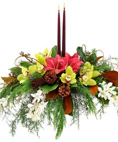 Winston Centerpiece: A stunning and sophisticated centerpiece with amaryllis and green cymbidium orchids nestled in a bed of winter greens. Christmas Flower Arrangements, Holiday Centerpieces, Christmas Flowers, Candle Centerpieces, Floral Arrangements, Plant Delivery, Flower Delivery, Dendrobium Orchids, Magnolia Leaves