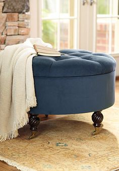 Save space and add a touch of elegance with this tufted storage ottoman!