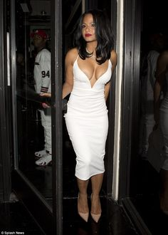Almost an overspill! Singer Christina looked sensational in her tight-fitting white dress,...