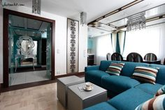 http://www.justsoakit.com/wp-content/uploads/2015/01/winsome-originality-interior-of-the-living-room-design-with-striped-cushions-on-beautiful-blue-fabric-sofa-also-gray-coffee-table-and-mirro-decoration-wall-970x646.jpg