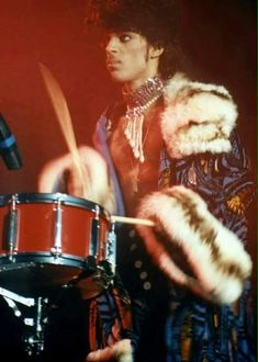 Prince playing the drums