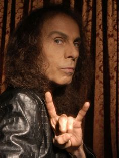 """Ronnie James Dio in a classic """"devil horns"""" pose"""