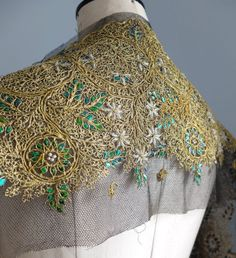 Beetle wing and gold embroidery on black tulle. Probably modern, from India, ready to be applied to buyer's garment.