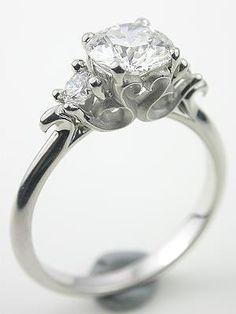 Pretty setting for a ring with side stones. - Heart and Scroll Motif Diamond Engagement Ring