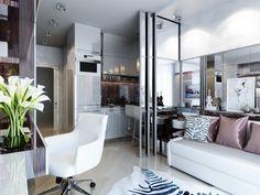 canapé droit en cuir blanc, chaise design assortie et carrelage sol beige pastel