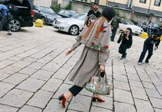 Susie Lau in a Gucci coat, shoes, and bag, J Brand jeans, and Prada scarf