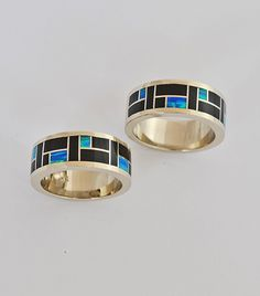 14 karat yellow Gold wedding rings with Black Jade and cultured Opal inlay.