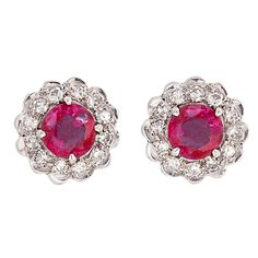 1stdibs   Ruby  and Diamond Rosette Earrings  Each earring centers 1 four prong-set ruby surrounded by small round single-cut diamonds, completed by a post and clutch back. Total ruby weight is approximately 2.0 carats, total diamond weight is approximately .48 carats.