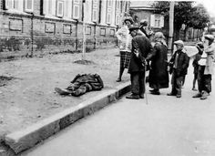 A victim of the Josef Stalin-ordered Holodomor famine, which killed millions of Ukrainians from 1932-33, is lying on a Kharkiv street in 1933.