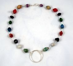"""Recycled paper beads made by the children at """"Village of Hope Uganda"""" and designed by Bybella"""