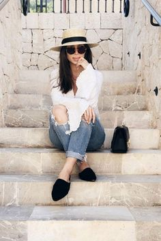 spring outfit, summer outfit, casual outfit, simple outfit, easy outfit, comfy outfit, summer vacation outfit, summer travel outfit, summer getaway outfit - boater hat, straw hat, white blouse, distressed boyfriend jeans, black flat mules, black shoulder bag, brown round sunglasses