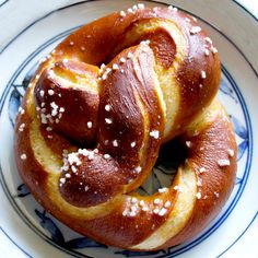 Our soft pretzel recipe begins with a delicious, buttery pretzel dough flavored with a hint of malt. It produces a crumb with a littlechew to it, butis still easy to work with.  A pretzel's uniquely flavored, dark brown crust comes frombeing dipped in a strong alkaline solution. Pros use food grade lye for the dipping solution,