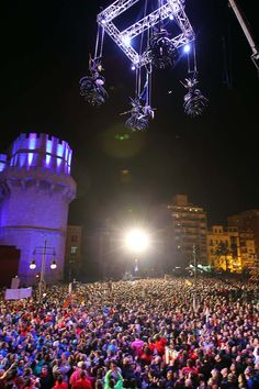 """Last Sunday Valencia celebrated the """"Cridà"""", the event that marks the kick off of the Fallas. The """"Fallera Mayor"""" announced the start of Fallas from the top of Torres de Serranos (one of the remaining doors of the ancient wall of the city) to all people attending. As you'll see from the pictures of fireworks, music, performances, a lot of people enjoyed this event. For more information, visit www.turisvalencia.es"""