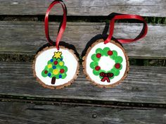 This is an easy fun family activity! Thumb/fingerprint wood slice ornaments. Wood slices can be found for sale at www.etsy.com/shop/lightofdaycreations