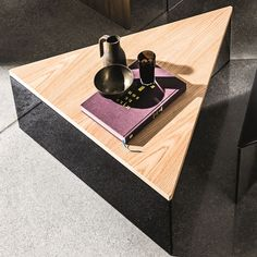 These triangular glass and wood coffee tables are formed from a rich material mix or materials. Luxurious black glass and wood. Mix and match several tables and surfaces to create the look.