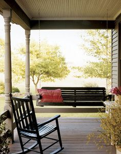 Porch swings & rocking chairs = the perfect country porch. :0)