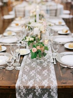 lace table runner over a rustic wooden table at a wedding reception or dinner party