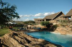 Manyatta Camp is located on the Tsavo East National Park boundary along Voi River. Nestled on the edge of the park it provides a peaceful and tranquil refuge. Manyatta Camp consist of 24 well appointed tented rooms, exuding excellent rustic African theme. At the rear of each tent is private swimming pool with a seating area and sun lounger's, all this over-looking the Voi river where many elephants and Baboon's and other wild animals frequent.