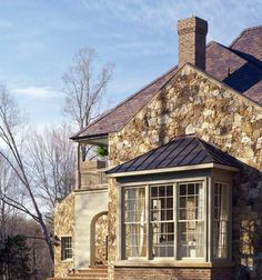 Back facade of French influence home designed by Kevin Harris Architect, LLC