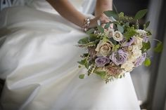 Vintage bridal bouquet.  Dusty purple roses, andromeda heather and seeded eucalyptus.
