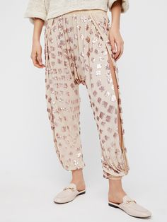 Break of Dawn Harem | Effortless harem pant featuring shimmering sequins allover and dramatic side vents for an ultra glam look.    * Elastic at the waist and ankles * Drop-crotch fit * Back pocket detail