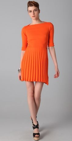 While this sweater dress has been presented as a summer dress, that may not be the case here in Houston. Still, I can't resisnt the bright color + fitted ribcage + pleats. $450