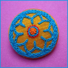 Embroidered button/brooch, via Flickr.