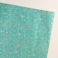 Our exclusive giftwrap features a paisley design in a sophisticated gold and green color palette. Handcrafted in India from recycled fabric remnants, this high-quality and eco-conscious paper is an eye-catching choice for any occasion.
