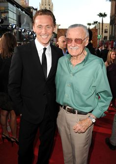 """If you want a cooler than cooler villain, who is also the nicest guy you will ever meet - I give you Loki's alter ego, Tom Hiddleston."" Stan Lee takes a picture with Tom Hiddleston at the Avengers premiere. :)"