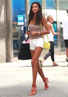 Runway-ready: The beauty reminded onlookers of her appeal, as she strolled the streets of the Big Apple.A beige singlet revealed her lithe arms and was teamed with white Daisy Dukes that highlighted her long and lean legs Sexy Outfits, Summer Outfits, Sexy Shorts, Beautiful Black Women, Amazing Women, Divas, Casual Dresses For Women, Clothes For Women, Daisy Dukes